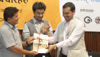Hon. Rabindra Adhikari hands over 'Ideas for Rebuilding Nepal' to Hon. VC of National Planning Commission